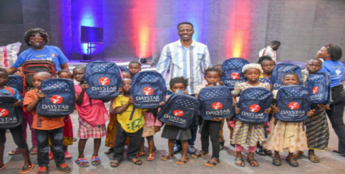 Pastor Sam Adeyemi and other church officials with the beneficiaries