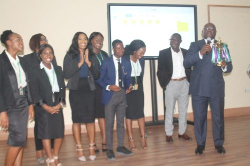 """Right: Group Managing Director SO&U SAATCHI AFRICA and Lead Pitch Judge, Mr. Udeme Ufot MFR presenting the winners of the Pitch Competition """"Pitch It"""" agency during the 1st APCON Induction and 2nd Annual Advertising Pitch Contest held at Covenant University Centre for Research, Innovation and Discovery, recently."""