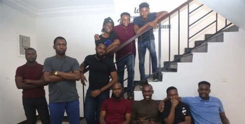 Dickson Nsofor (M) on staircase with colleagues