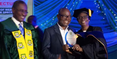 Dr. Itegboje receives plaque from the Rector, Engr. Omokungbe. At the center is Mr Itegboje
