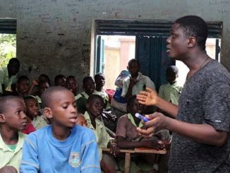 Daniel Bamidele speaking to some of the students
