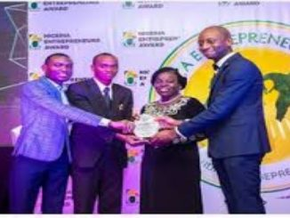 Director, Centre for Entrepreneurial Development Studies, Covenant University, Dr. Felicia Olokoyo (2nd right) and Chairman Centre for Economic Policy and Development Research (CEPDeR) in Covenant, Professor Evans Osabuohien (2nd left), receiving the Most Outstanding Higher Institution of the Year Award from the 2019 Nigeria Entrepreneurs Award organisers
