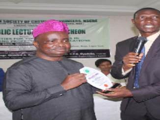 Group General Manager (GGM) ETD, NNPC, Engr. Johnson Awoyomi, FNSChE, receiving an award from the Lagos/Ogun chapter Chairman, Dr. KFK Oyedeko at the annual public lecture and luncheon of the Nigerian Society of Chemical Engineers, NSChE which held in Lagos on Saturday, 14th December, 2019.
