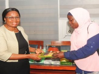 Deputy Rector Administration, Dr. Titilayo Ukabam receiving a copy of the books from the PANAFSTRAG's Programme Coordinator, Mrs. Arinola Bello.
